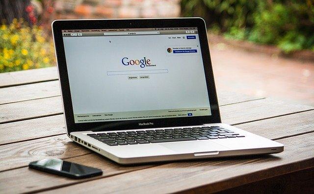 Laptop displaying Google search page